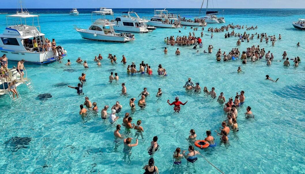 Caymanøyene i Det karibiske hav er kjent for sine hvite strender og et populært turistmål.